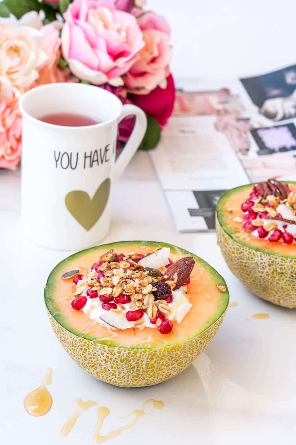 Healthy & super quick cantaloupe muesli breakfast bowls filled with low fat yogurt, homemade granola, pomegranate and a drizzle of honey. This all in one, easy to make breakfast is all you need in order to start the day on the right foot! Click through for the full recipe @ www.hedonistit.com